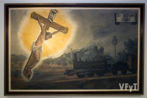 Pintura que recuerda la protección del Cristo de los Afligidos a los vecinos Riba-roja en el accidente de tren (actualmente se halla en la sacristía del templo parroquial). Foto de Manolo Guallart.